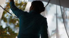 Woman drapes the column with  white cloth - stock footage