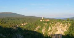 Skocjan caves cave national park Slovenia pan mountains valley forest woods sky Stock Footage