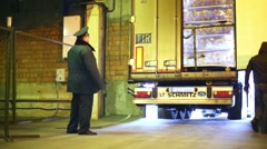 Driver opens rear doors of truck in customs warehouse Stock Footage