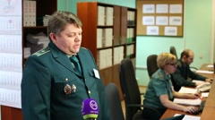 Customs officer answers questions to press representatives Stock Footage