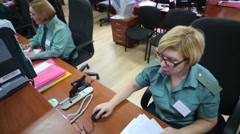 Female customs officers work at workplaces in office Stock Footage