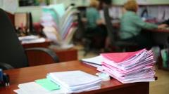 Desk full of documents piles in office of Kiev customs house. Stock Footage