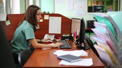 Female customs officer works with computer program at workplace Stock Footage
