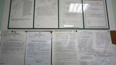Notice board with plenty of documents in office Stock Footage