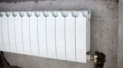 Heating radiator mounted at wall niche in new  built room. Stock Footage
