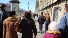 People walk along Nevsky Prospekt in St. Petersburg Stock Footage