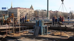 Workers mount plate with cranes during repairing Palace bridge Stock Footage