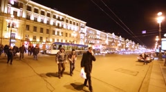 People cross the Nevsky Prospect at night in St. Petersburg Stock Footage