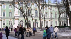 People walk near buildings of State Hermitage Museum. Stock Footage