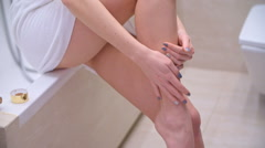 Sensual Girl Massaging Her Legs Stock Footage