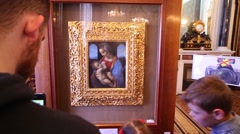 Visitors view painting The Litta Madonna by Leonardo da Vinci Stock Footage