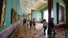 Visitors in the room, containing paintings at State Hermitage. Stock Footage