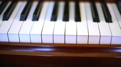 Keyboard of old piano, keys moving without pianist. Stock Footage