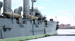 Cruiser Aurora on frozen Bolshaya Nevka river against Embankment Stock Footage