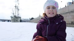 Little girl sits on frozen river against ship and tells poem. Stock Footage