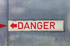 danger sign on an old airplane - stock photo