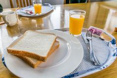 Easy breakfast with orange juice, bread, and coffee Kuvituskuvat