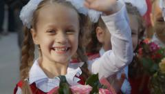 Pupils at the school celebration, happy girls - stock footage