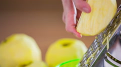 Grating apples close up Stock Footage
