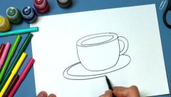 The man quickly draws and a Cup of aromatic coffee Stock Footage