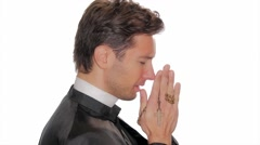 Young catholic priest saying a prayer Stock Footage