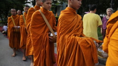Buddhist monks accepting offerings  - stock footage