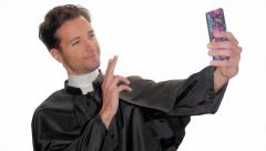 Modern young priest taking a selfie Stock Footage