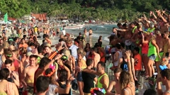 Boys and girls dancing at the Full Moon party on Haad Rin beach.  Island Phangan Stock Footage