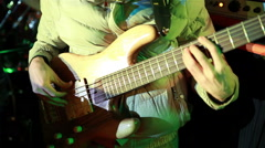 Bassist playing at a rock concert. Stock Footage