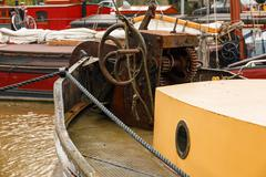 old boat equipment fore deck - stock photo