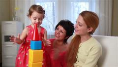 Little girl and her mother and grandmother playing with children's blocks. Stock Footage