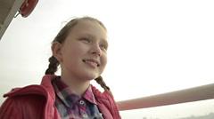 Teenage ponytail blonde pink jacket girl, smiling,  banister, on boat voyage Stock Footage