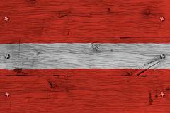 latvia national flag painted old oak wood fastened - stock photo