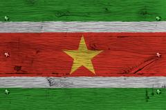 suriname national flag painted old oak wood fastened - stock photo