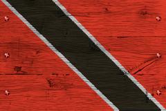 trinidad tobago national flag painted old oak wood fastened - stock photo