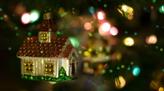 House toy rotates on the New Year Tree and snowflakes falling Stock Footage