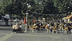 Berlin 1982: people walking in the west side of the city Stock Footage