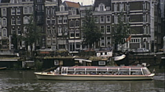 Amsterdam 1980: sightseeing cruise on the canals Stock Footage