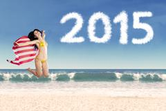 Woman with american flag in new year holiday Kuvituskuvat