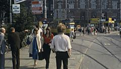 Amsterdam 1980: people walking in front of the Central train station - stock footage