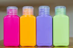 Small colored plastic bottles for traveling Stock Photos