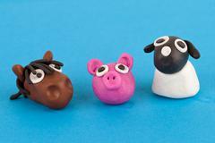 Cute plasticine farm animals collection - pig, horse, sheep. Stock Photos