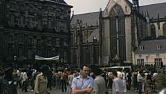 Amsterdam 1980: crowd in Dam Square - stock footage