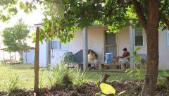 Women Talking on Porch on Micronesian Island of Yap Stock Footage