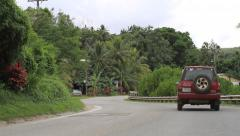 Jeep on Winding Road through Jungle on Micronesian Island of Yap Stock Footage