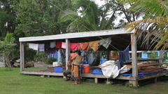 Couple and Laundry on Micronesian Island of Yap Stock Footage