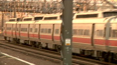 Passenger train stopped, panning zoom out at station. Stock Footage