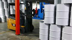 Adapted lift truck stowing away maple syrup barrels - stock footage