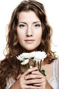 Woman face with white flowers Stock Photos
