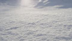 CLOSE UP: Fresh snow glittering in the sun - stock footage